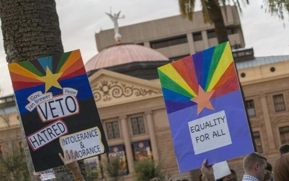 Arizona governor vetoes antigay law under threat of another boycott