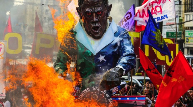 Filipino antiwar movement burns Obama effigy to protest his war mongering