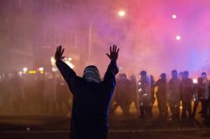 Lone protester in Baltimore (Matt Rourke:AP) Apr 29 2015