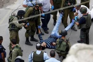 Injured Pal & IDF (AP Photo:Nasser Shiyoukhi) Oct 27 2015