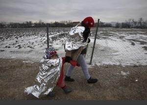 Refugees in thermal blankets ( Boris Grdanoski:AP) Jan 24 2016