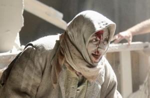 Old Aleppo, Syria injured woman (REUTERS:Abdalrhman Ismail) Apr 30 2016