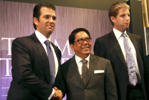 Two Trumps and Jose EB Antonio (Pat Roque:AP)
