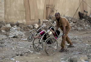Mosul man with kids in wheelchair (Maya Alleruzzo:AP) May 13 2017