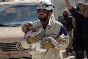 White Helmet with injured child Idlib Oct 2015 :Khalil Ashawi:Reuters: May 9 2017