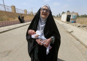 Mosul elderly woman and baby ( REUTERS:Alaa Al-Marjani) July 5 2017