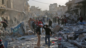 Residents in the northern Syrian Atareb look for survivors after an air raid. © Zein Al Rifai : AFP : Getty Images