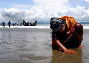 Ro woman touching down in Bangladesh (REUTERS:Danish Siddiqui) Dec 31 2017