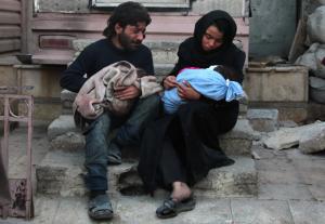 Douma Syria couple mourning child (Hamza Al-Ajweh:AFP:Getty Images) Jan 10 2018