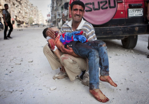 Syrian father in Aleppo with son killed by Syrian bombers in October 2012