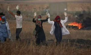 Razan & other voluntary medics with hands up June 1 2018