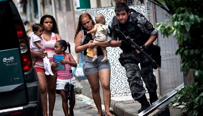 "Brutal military occupation of favelas in Brazil labeled a ""pacification"" program"