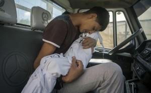 Gazan boy mourning sister August 3 2014
