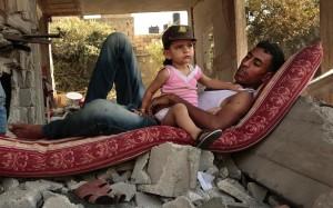 Gazan man with child August 6 2014