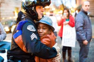Blck kid hugging cop (Johnny Nguyen:AP) Dec 3 2014
