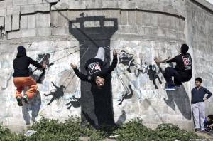 Palestinian parkour at Banksy image of Israeli watch tower (Mohammed Abed:AFP) Mar 15 2015