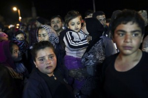 Lesbos immigrants ( Angelos Tzortzinis:AFP:Getty Images) Apr 20 2015