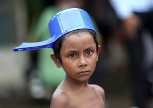 Rohingya boy with pot on head  (AP Photo:Tatan Syuflana) May 24 2015