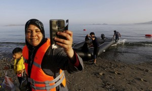 Syrian immigrant in Greece taking slefie (Yannis Behrakis:Reuters) May 26 2015