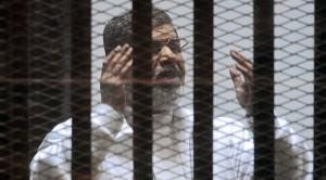 Mohamed Morsi in cage (EPA) June 16 2015