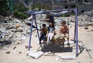 Gaza children on swing (Said Khatib:AFP) July 22 2015