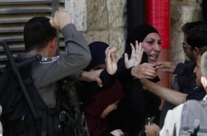 IDF attacking women at Al Aqsa ((AP Photo:Mahmoud Illean) July 27 2015