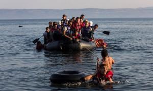 Syrian & Afghan refugees at Lesbos (Santi Palacios:AP) July 28 2015