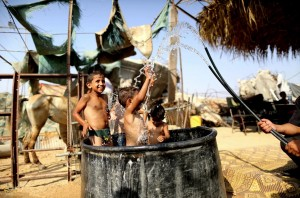 Gaza cooling off in pool ( Nidal Alwaheidi:Demotix:Corbis) August 6 2015