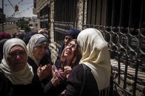 Grieving Mohammed Lafi Abu Latifeh (Ilia Yefimovich:Getty Images) August 1 2015