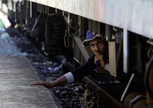 Refugee under train (AP Photo:Boris Grdanoski)  August 18 2015