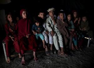 Afghan refugees watching land mine film ( Ahmad Masood:Reuters) Sept 6 2015