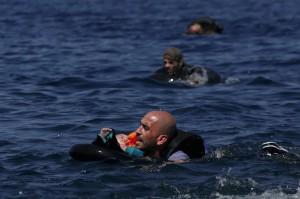 Syrian & child in Aegean (REUTERS:Alkis Konstantinidis)  Sept 15 2015