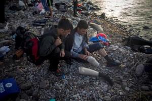 Afghan amputee:refugee at Lesbos (AP Photo:Santi Palacios) Oct 9 2015