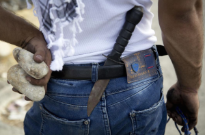 Pal with knife (AP Photo:Majdi Mohammed) Oct 19 2015