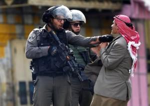 Roughing up Palestinian man in Hebron (AP Photo:Nasser Shiyoukhi)  Oct 11 2015