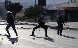 Three Israeli soldiers firing (Jaafar Ashtiyeh:AFP:Getty Images) Oct 21 2015