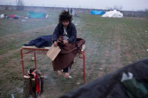 Iranian child refugee on Mac:Grk border (AP Photo:Petros Giannakouris)  Dec 5 2015