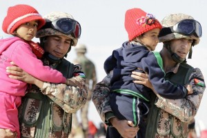 Jordanian soldiers & Syrian kids (Khalil Mazraawi:AFP:Getty Images) Jan 20 2016