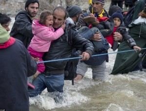 Crossing river at Idomeni (AP) Mar 15 2016