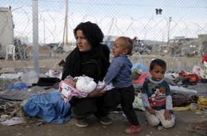 Refuee family at Grk-Mac border (REUTERS:Marko Djurica) Mar 9 2016