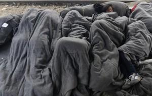 Refugees sleeping on tracks Idomeni (Darko Vojinovic:AP) Mar 28 2016