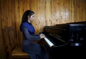 Afhan pianist (Ahmad Masood:Reuters) Apr 18 2016