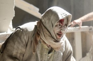Old Aleppo, Syria injured woman (REUTERS:Abdalrhman Ismail) Apr 30 2016