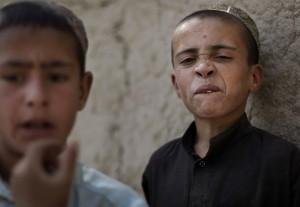 Afghan boys watching US-NATO patrols (AP Photo:Anja Niedringhaus) May 18 2016