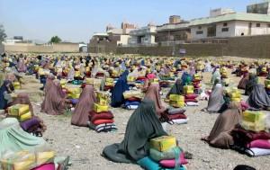 Afghan women waiting for charity (Muhammad Sadiq:EPA) May 4 2016