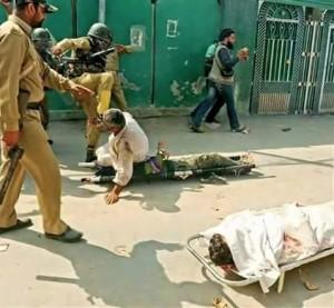 Indian soldier kicking Kashmiri man