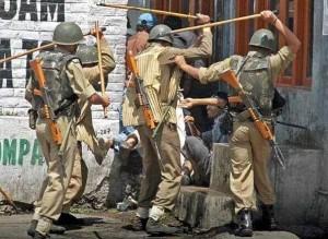 Indian soldiers beating Kashmiri man