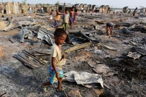 Rohingya boy in fire at camp (REUTERS:Soe Zeya Tun) May 5 2016