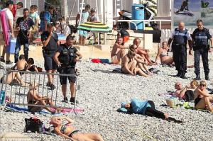 French Gendarmes & burkini criminal Aug 23 2016