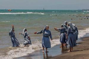 Nuns wading at beach Aug 25 2016